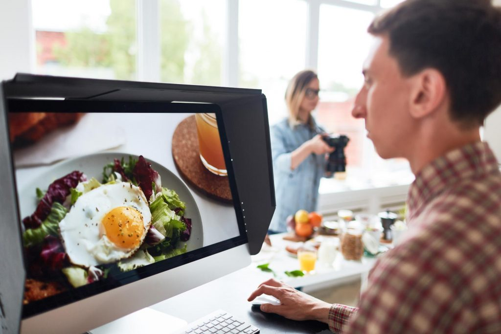 Professional food videographer editing