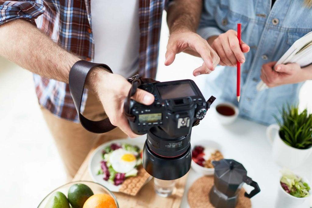 Professional food videographers manipulating a camera